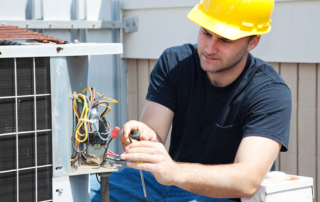 professional performing HVAC maintenance