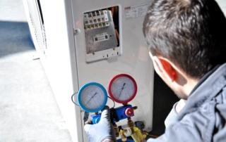 repairman investigation air conditioner troubles