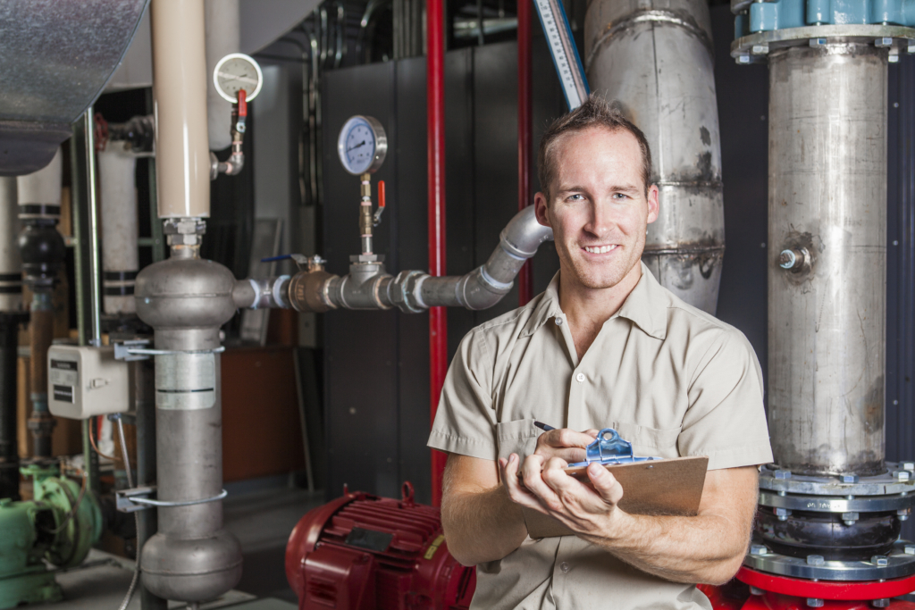 Technician inspecting St George heating