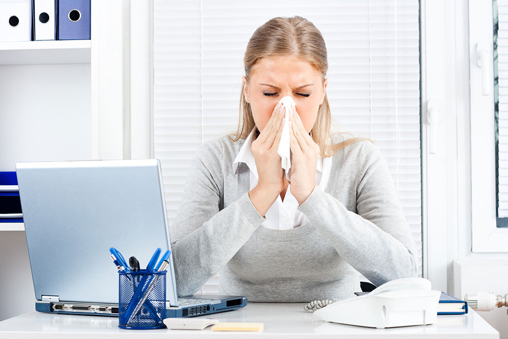 Woman Sneezing Because of Allergies Due to Inefficient HVAC System