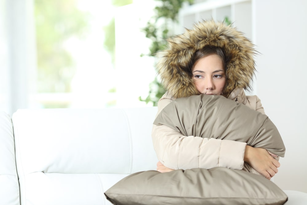Woman Wearing Coat In Cold Home