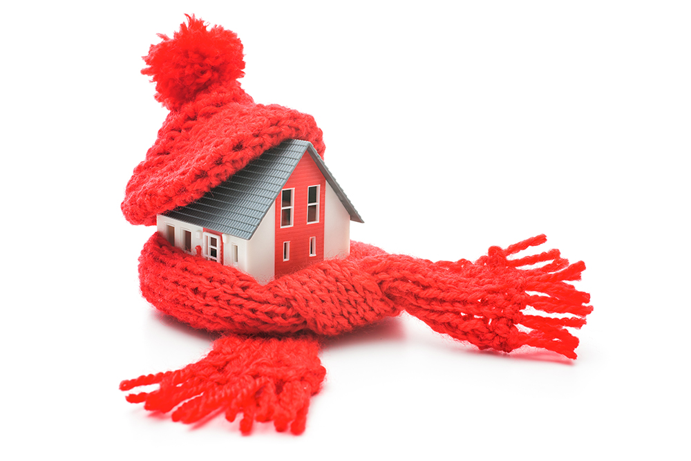A house wrapped in a winter hat and scarf because the furnace stopped working